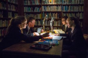 Group of students working in the library