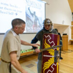 A photo taken by Lillian Spibey entitled: Cranleigh UV Form Lecture Ben Kane & the Roman Army-1189